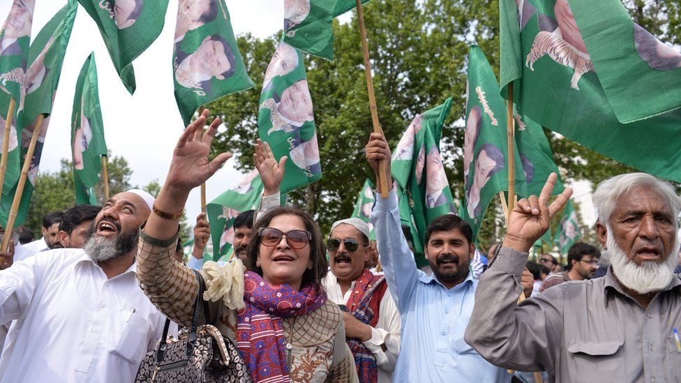 Supporters of the ruling party Pakistan Muslim League-Nawaz (PML-N) celebrate after a Supreme Court verdict on the Panama Papers in Islamabad on April 20, 201