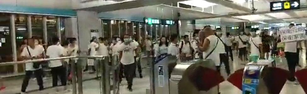 Men in white T-shirts at Yuen Long