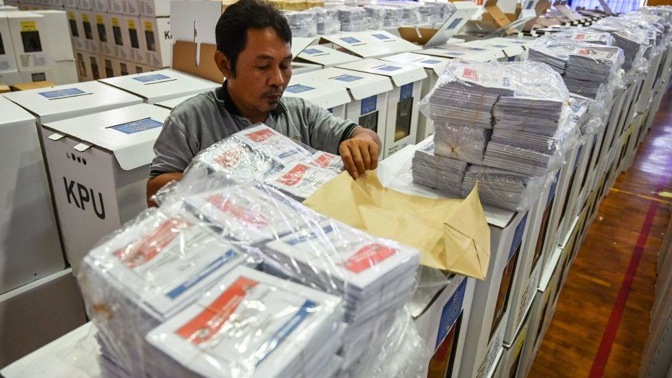 An official prepares ballots for Indonesia's elections