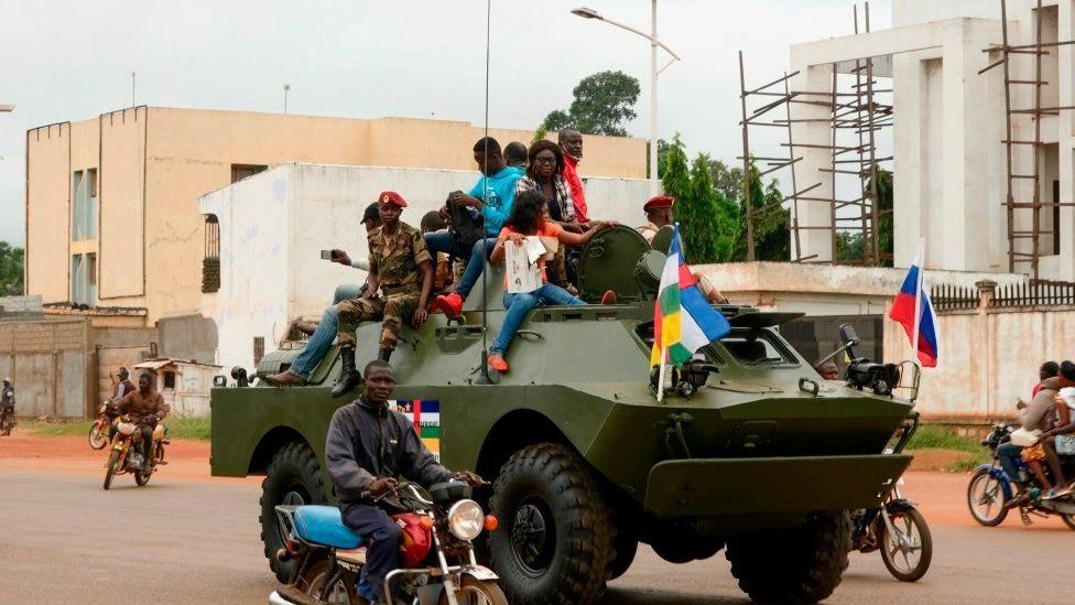 A Russian armoured personnel carrier (APC) is seen driving in the street during the delivery of armoured vehicles to the Central African Republic army in Bangui