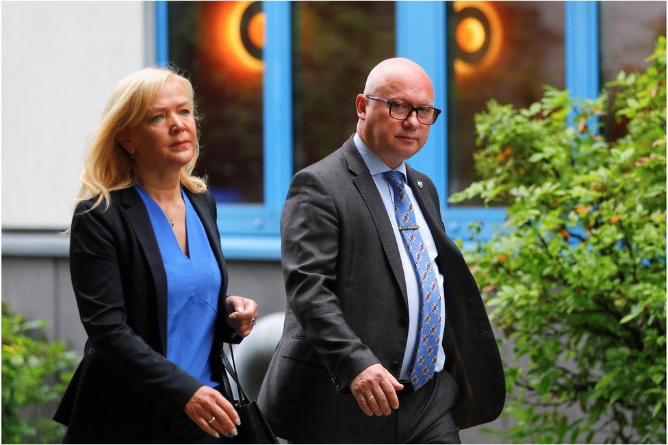 Oliver Kirchner, the top candidate of the far-right AfD (Alternative fuer Deutschland) party, and his wife Tatiana arrive to cast their votes for the federal state election of Saxony-Anhalt, in Magdeburg, Germany, June 6, 2021
