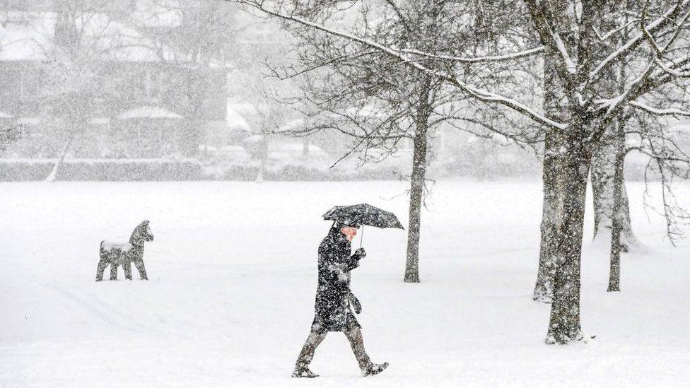 Person walks through Victoria Park in Glasgow