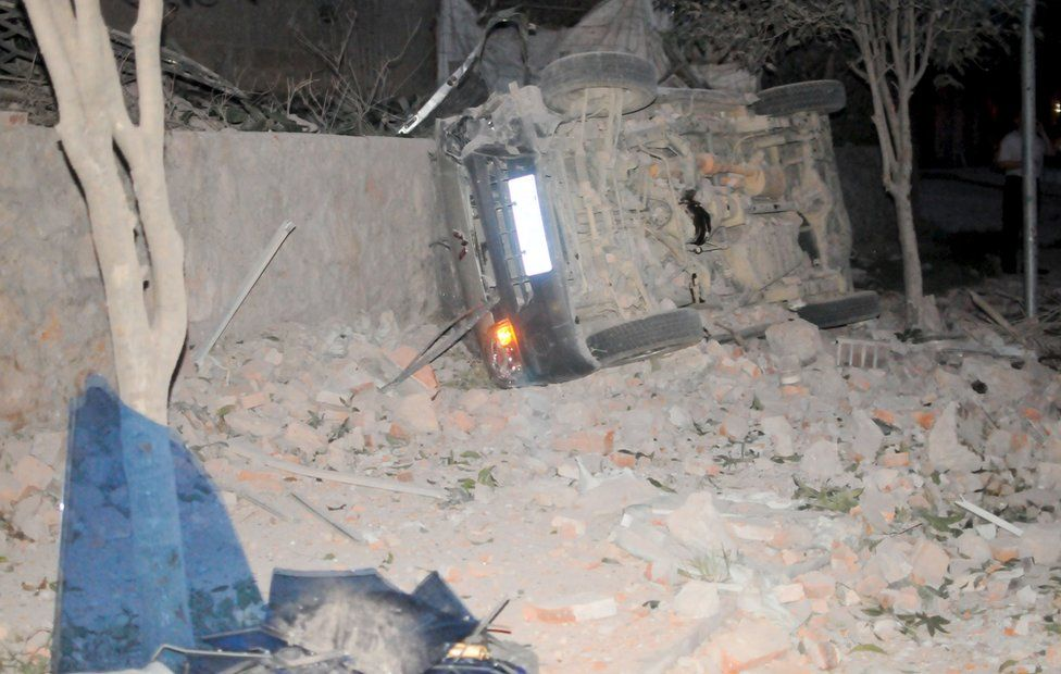An overturned car is seen after explosions hit Liucheng county, Guangxi Zhuang Autonomous Region, China, 30 September 2015.