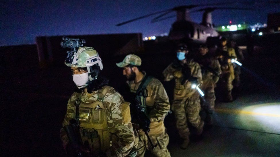 Taliban fighters from the Fateh Zwak unit, wielding American supplied weapons, equipment and uniforms, enter into the Kabul International Airport 31 August 2021