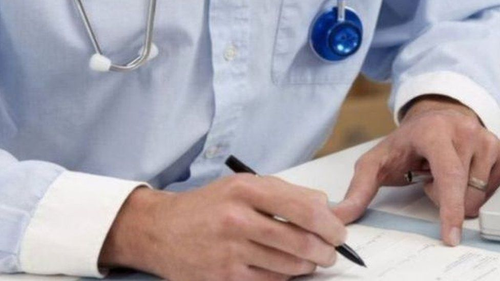 generic doctor holding pen