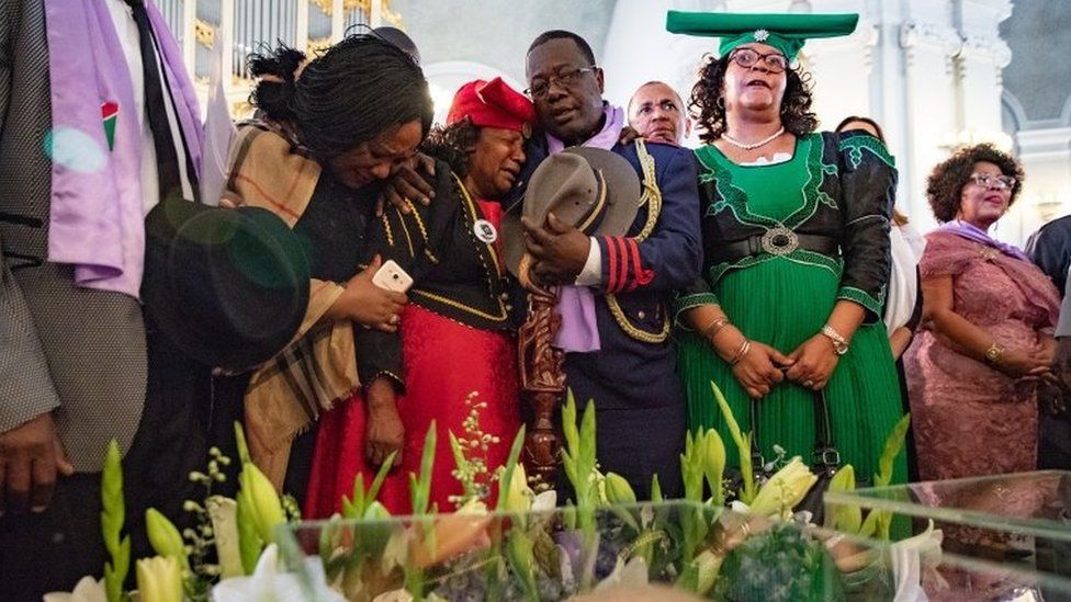 Members of a Namibian delegation mourn during a ceremony where human skulls are displayed in 2018 file photo
