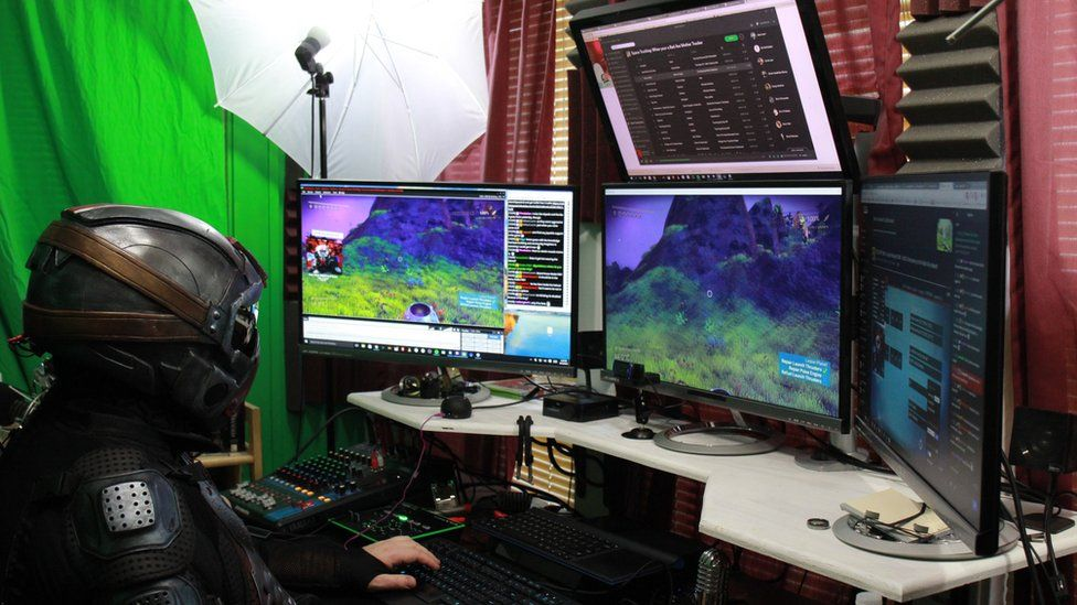 A picture of Joe Marino in front of his gaming setup