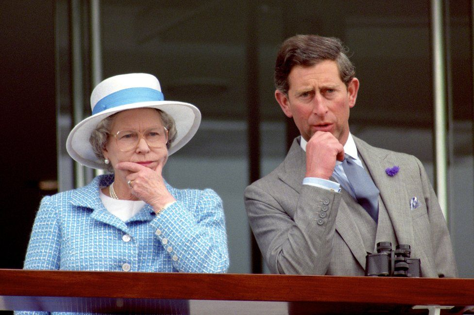 Queen Elizabeth II and the Prince of Wales appearing thoughtful as they watch the races at Epsom