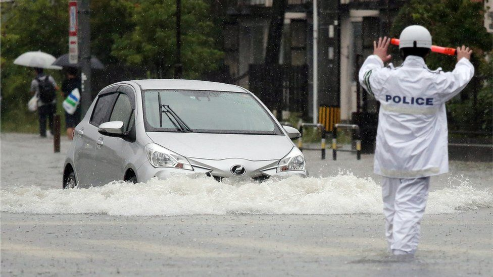 Japan floods: Three people dead as heavy rains pound south