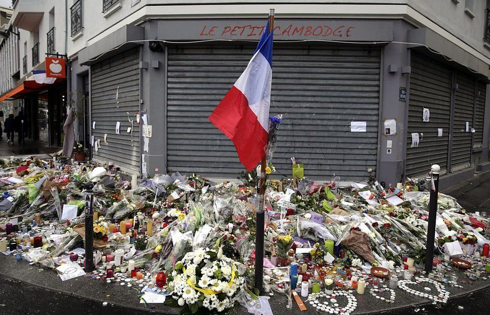 Flowers left outside Le Petit Cambodge in Paris, site of a shooting in November 2015