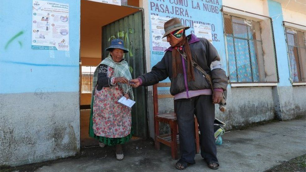 Voters leave at a polling station in Patamanta, Bolivia, on 20 October 2019