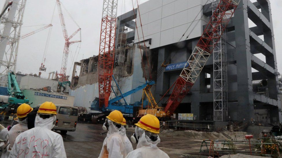 Covers are installed on the unit 4 reactor building at Tokyo Electric Power Company's Fukushima Dai-ichi nuclear plant in the town of Okuma, Fukushima prefecture in Japan on 12 June 2013