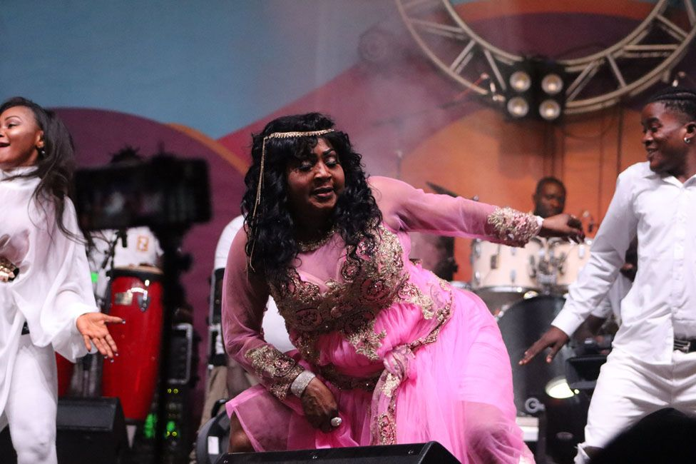 A performer dancing on stage