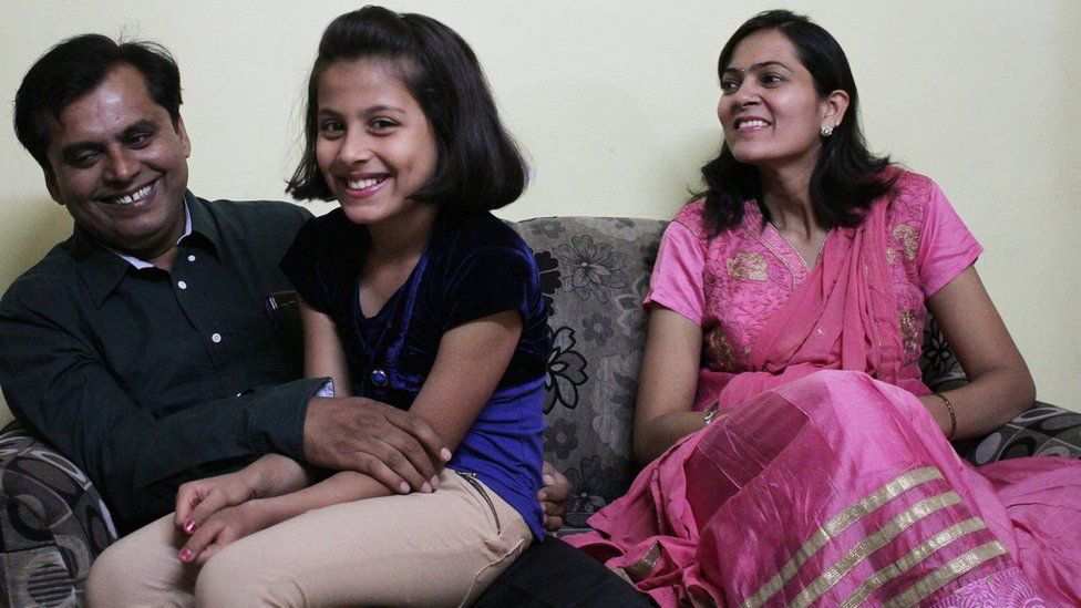 Dr Ganesh Rakh with his wife and daughter