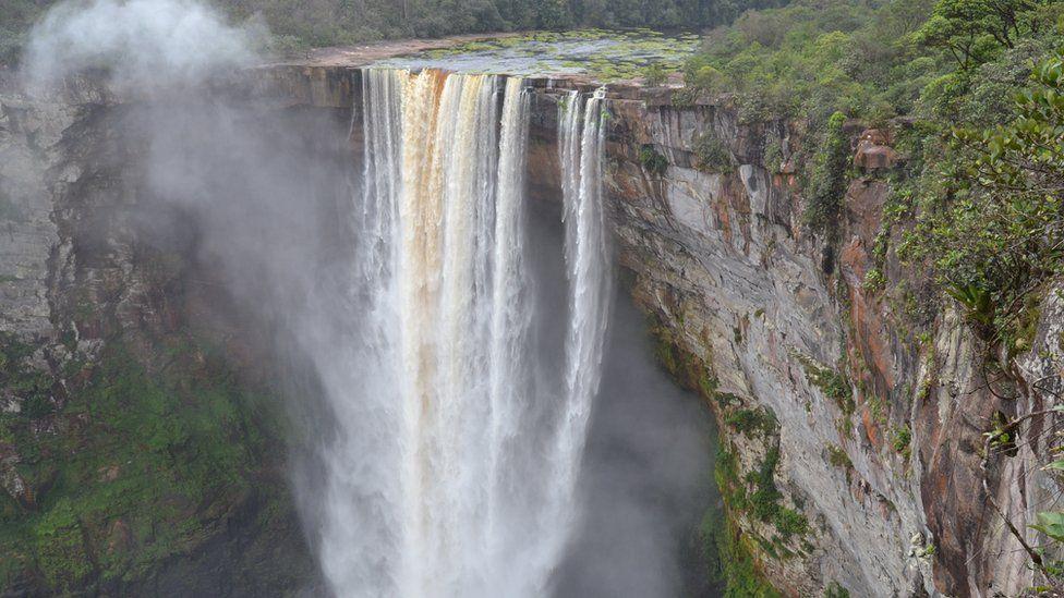 "741-foot high Kaieteur Falls in Guyana""s verdant rain forest"