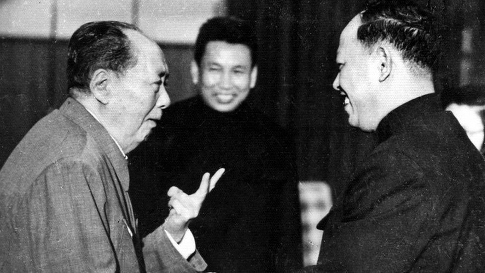 """:A photo taken in the 1970""""s outside of Cambodia, shows China""""s chairman Mao Zedong (1893 - 1976) (L) greeting top Khmer Rouge official Ieng Sary (R), also known as """" brother number three"""", while Khmer Rouge leader Pol Pot (C) looks on."""