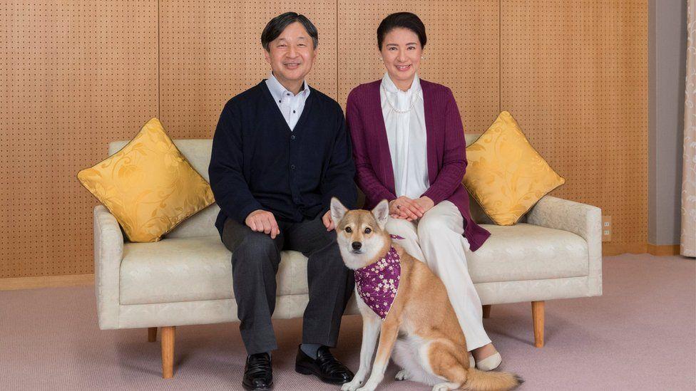 Japan's Crown Prince Naruhito and Crown Princess Masako pose for a photograph with their pet dog Yuri, 4 December 2018