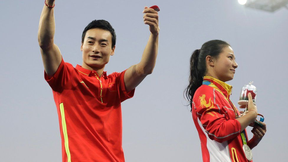Qin Kai gives a thumbs up after silver medallist He Zi accepted his proposal
