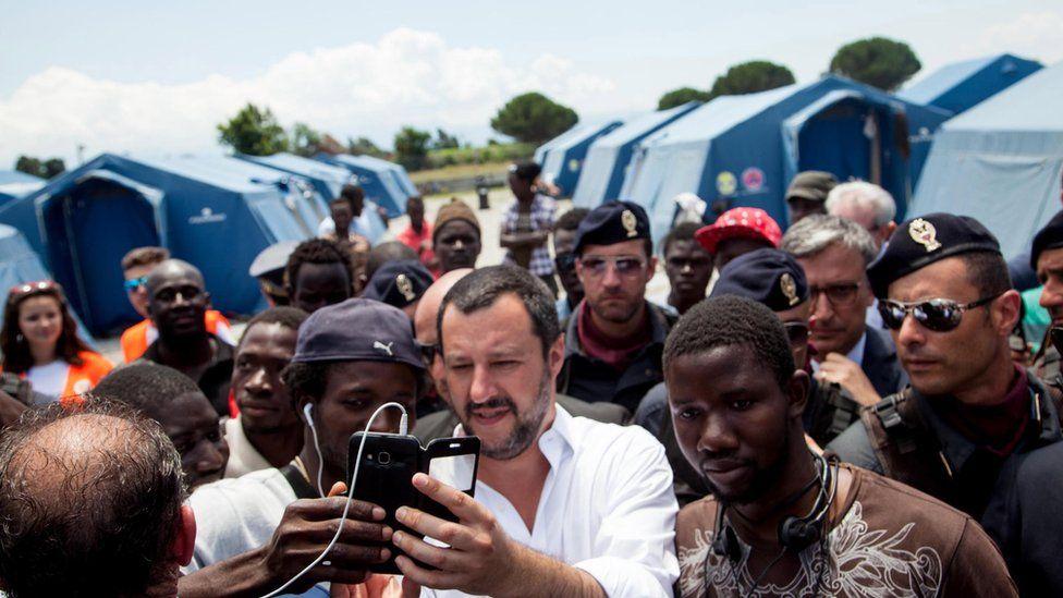 "Italian Interior Minister, Matteo Salvini (C) visits a migrants"" tent city in San Ferdinando - 10 July 2018"