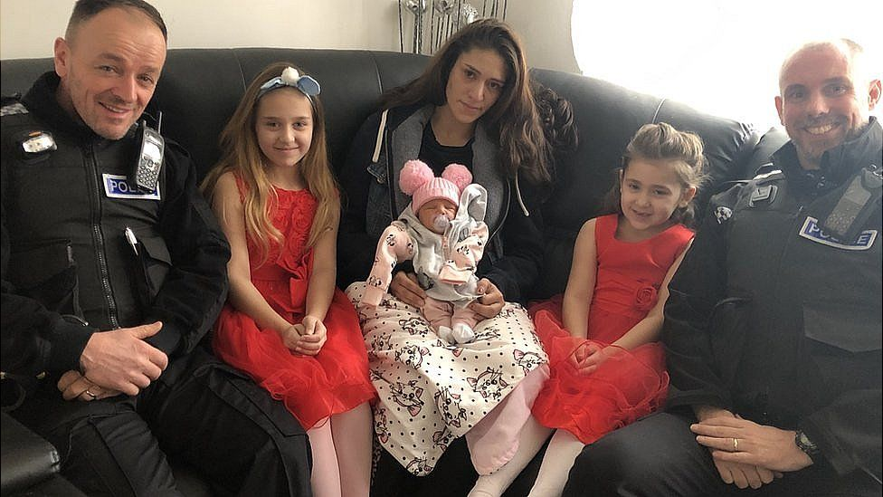 PC Dennis Lewis, Natalie Behakova, Lucie Behakova with baby Amilie, Sofia Behakova and PC Martin Lindsey.