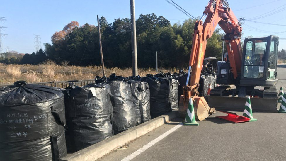 Bags of soil that may have been contaminated sit on an empty street in Fukushima prefecture.