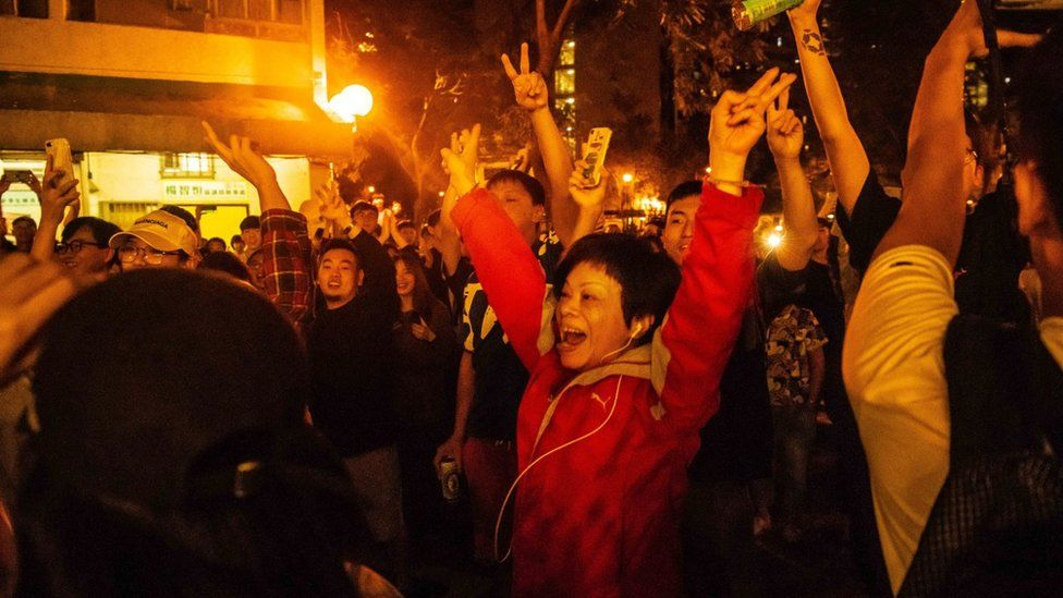 Hong Konger celebrating on election night