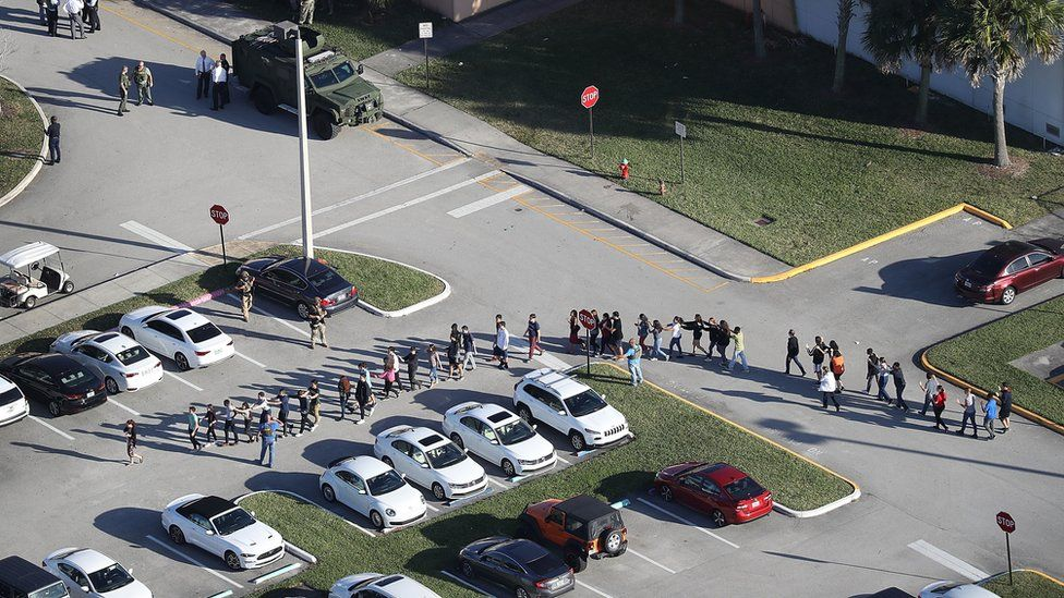 Students led from the scene of the shooting