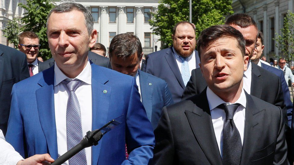 Ukraine's President Volodymyr Zelensky (R) walks from the parliament to the presidential administration office accompanied by his aide Serhiy Shefir