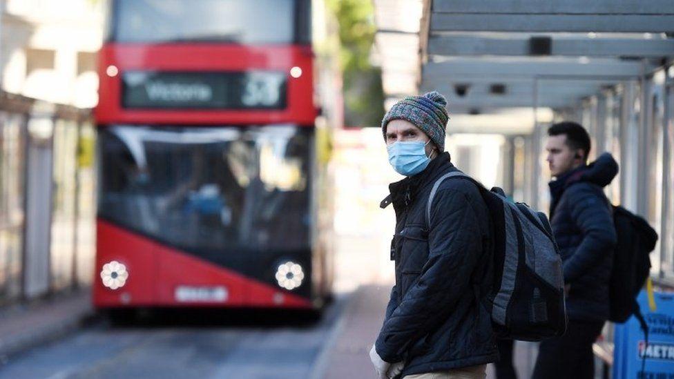 Commuter wearing mask