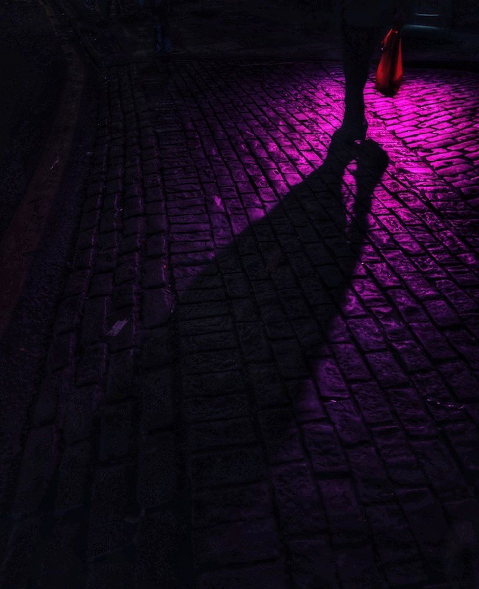 Shadow on cobbles