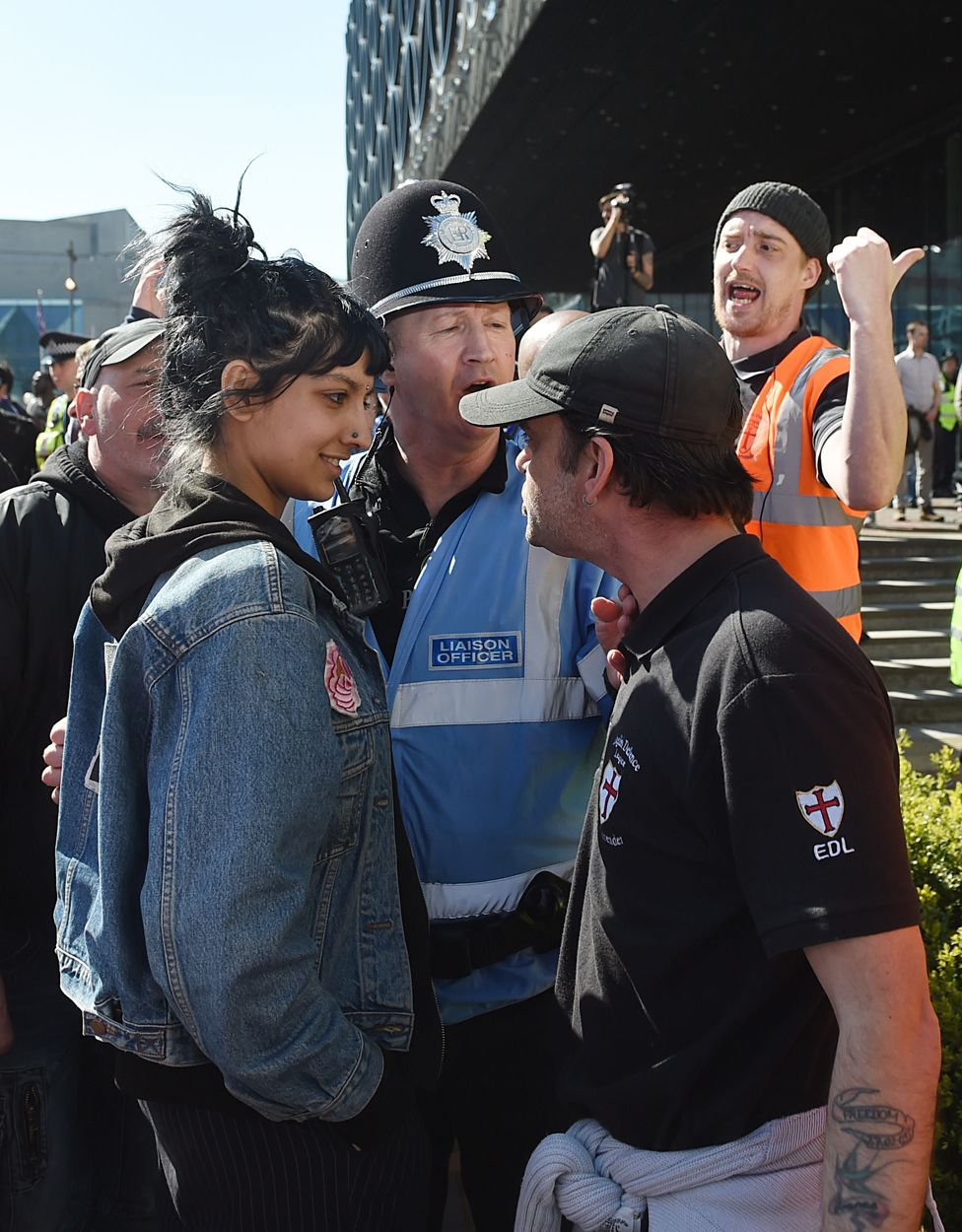 An English Defence League (EDL) protestor clashes with a member of the public during a demonstration in the city of Birmingham