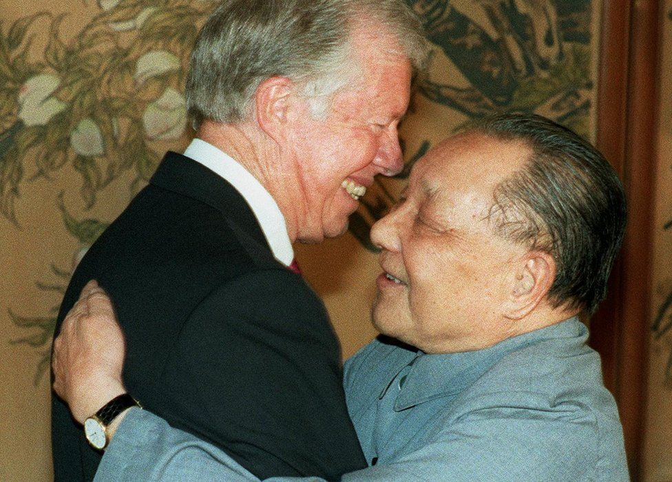 File photo shows former US President Jimmy Carter and China's paramount leader Deng Xiaoping hugging each other 29 June 1987 in Beijing, after signing an agreement between China and Global 2000