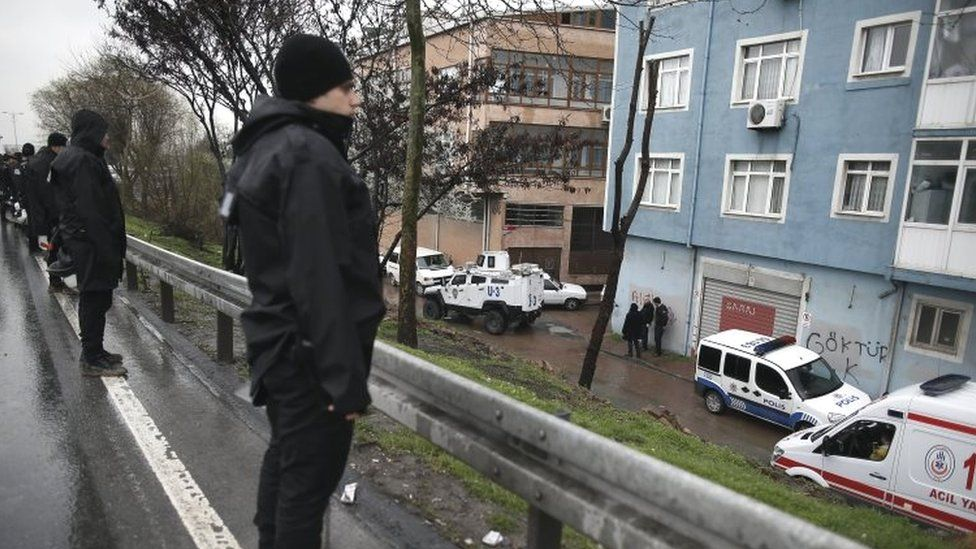 Riot police surround the area during a police operation against two attackers (03 March 2016)