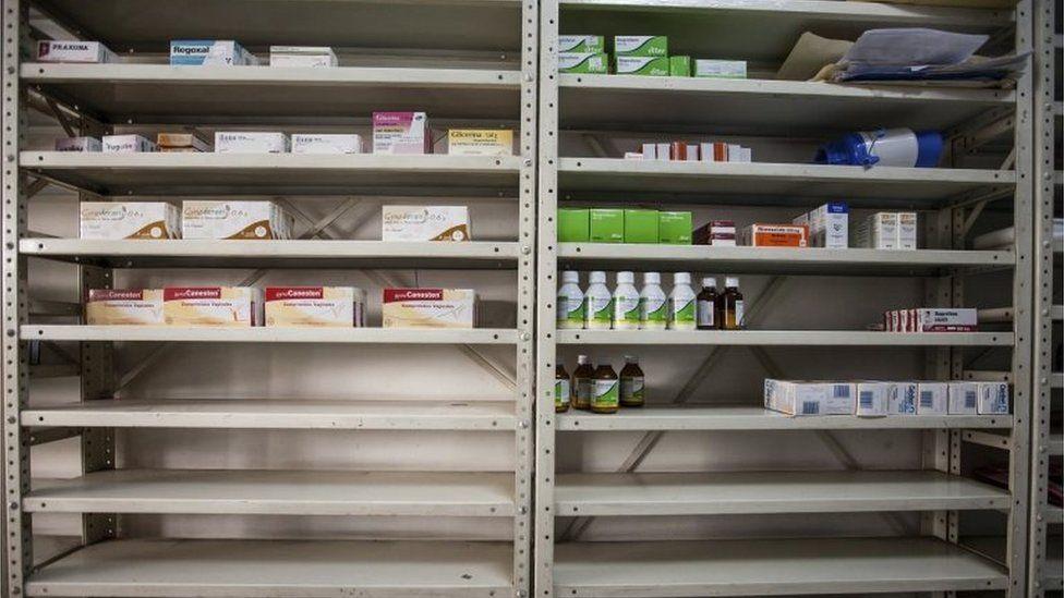 Half-empty shelves at a drugstore in Caracas, Venezuela, 14 April 2016.