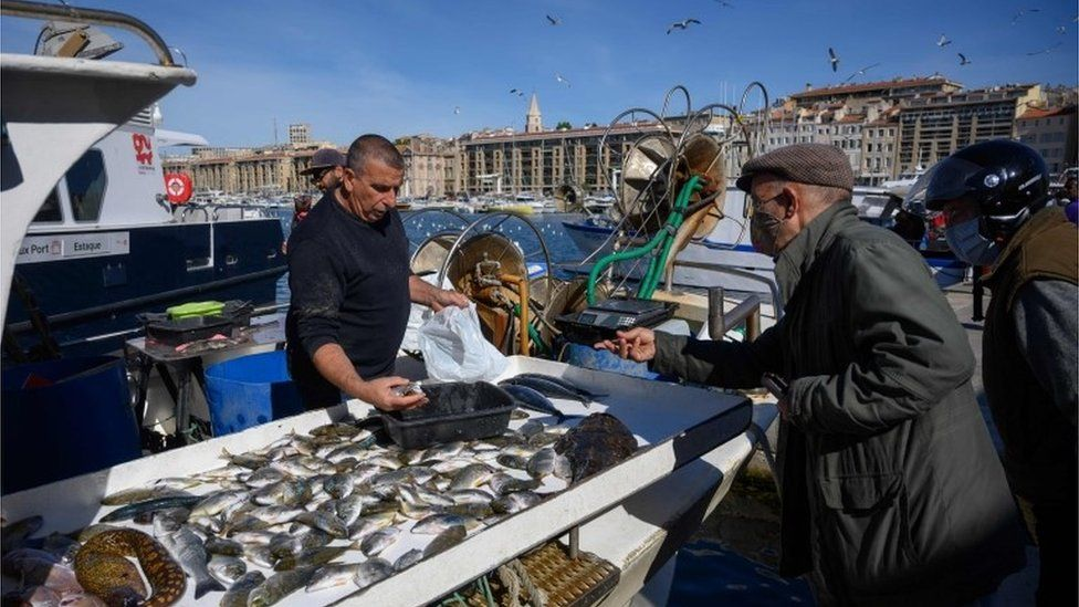 People buy fish in Marseille, 3 May