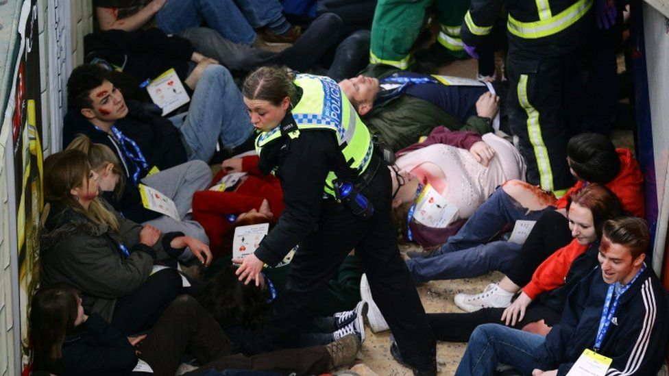 A police officer with volunteer casualties