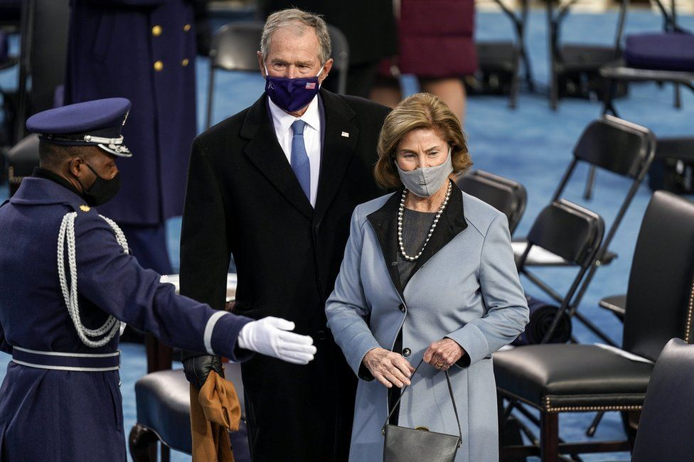 Former President George W. Bush and former First Lady Laura Bush are shown their seats