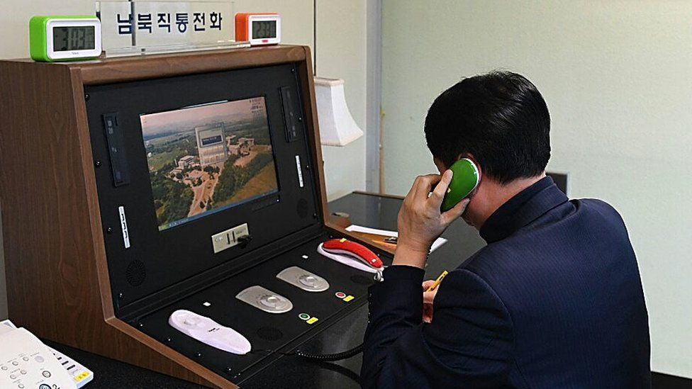 Picture of South Korean speaking to the North