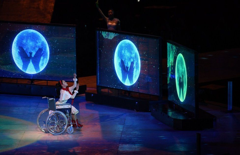 A performer in a wheelchair performs at the closing ceremony