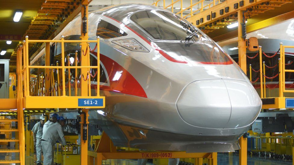 China's Fuxing high-speed bullet trains at the manufacturing line of CRRC Qingdao Sifang