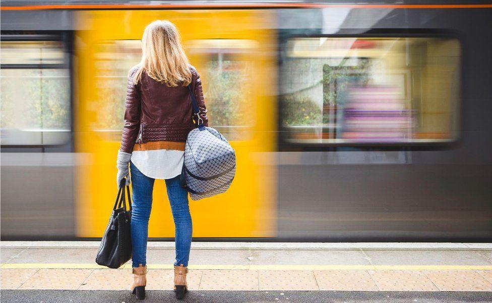 Woman on tube platform