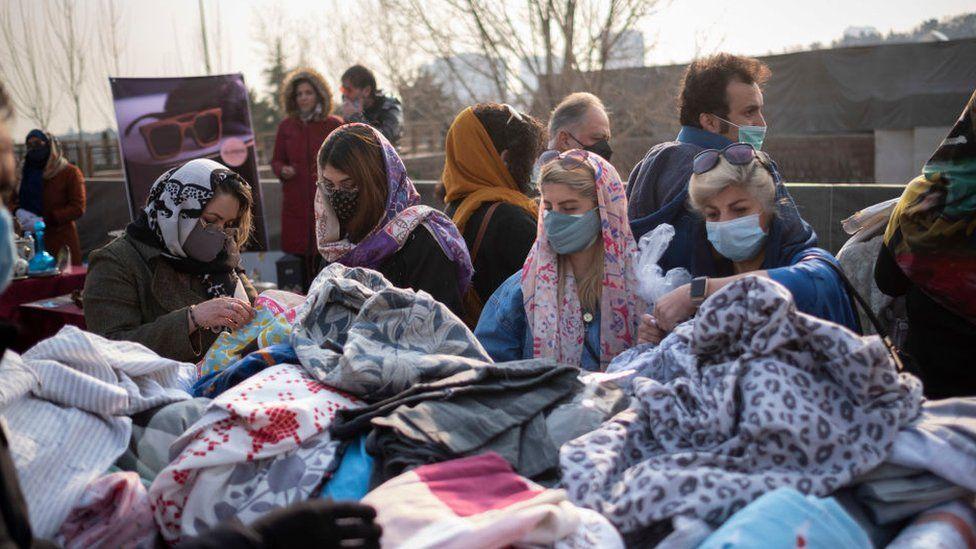 Women shopping at a bazaar in Iran