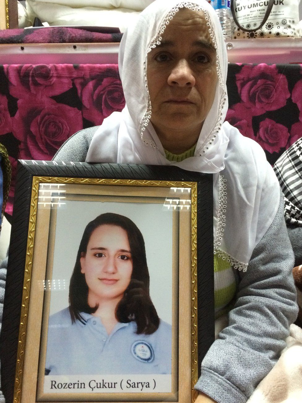 Fahriye Cukur with picture of her daughter