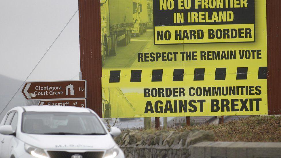 A motorist crosses over the border from the Irish Republic into Northern Ireland near the town of Jonesborough, Northern Ireland