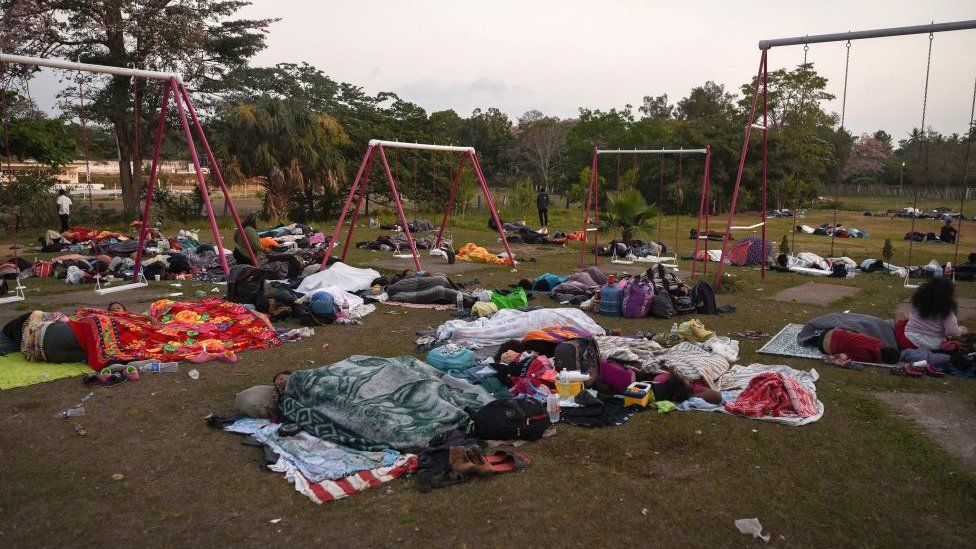 migrants sleep in a schoolyard on their way to the US