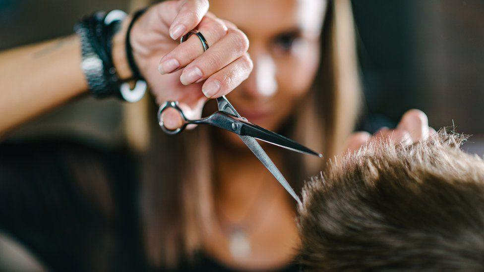 A woman cutting hair