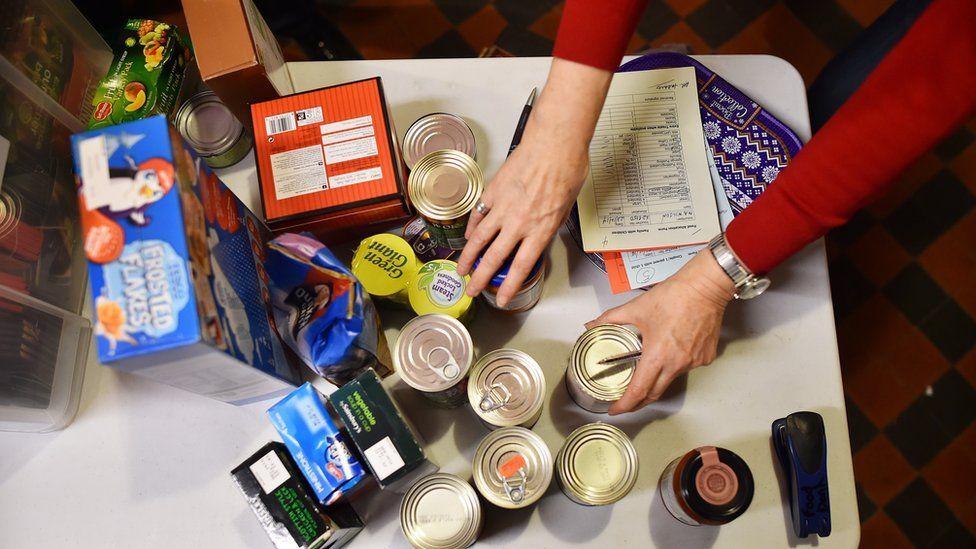 Volunteer selects product at food bank