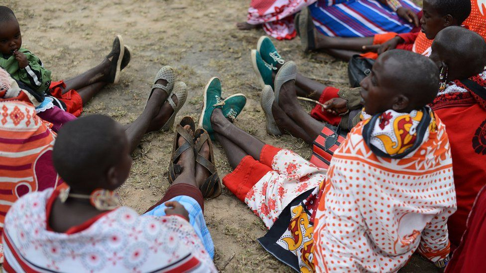 Kenyan Maasai women gather during a meeting dedicated to the practice of female genital mutilation (FGM) in which several participants voiced opposition to a ban currently in place, on June 12, 2014, in Enkorika, Kajiado, 75km from Nairobi
