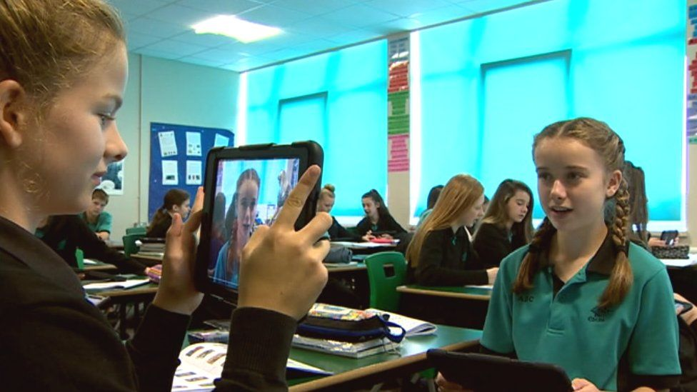 Pupils at Cardiff's Ysgol Gyfun Bro Edern use iPads in lessons