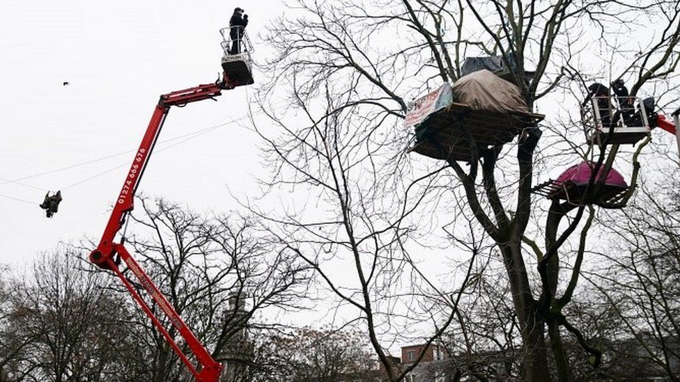 Enforcement officers using aerial platforms to try and coax HS2 protesters down from trees